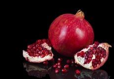 Ripe pomegranate fruit isolated on a black background Stock Photography