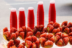 Ripe pomegranate. Fruit and juice in bottle Royalty Free Stock Images