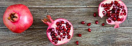 Ripe pomegranate fruit for making fresh pomegranate juice on wooden table. Healthy eating concept. The top view. Banner stock images