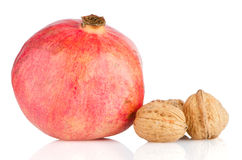 Ripe pomegranate fruit and nuts Stock Images