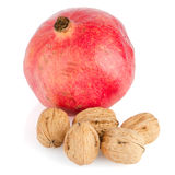 Ripe pomegranate fruit and nuts Royalty Free Stock Photos