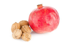 Ripe pomegranate fruit and nuts Stock Photography