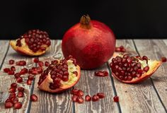 Ripe pomegranate fruit on old brown wooden stock photography