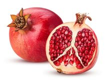 Ripe pomegranate fruit and one cut in half stock image
