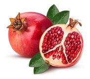 Ripe pomegranate fruit and one cut in half with leaf stock photos