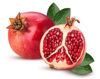 Ripe pomegranate fruit and one cut in half with leaf stock images