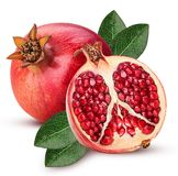 Ripe pomegranate fruit and one cut in half with leaf royalty free stock photos