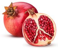 Ripe pomegranate fruit and one cut in half stock photos