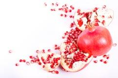 Ripe pomegranate fruit and seeds isolated on white background. Royalty Free Stock Photo