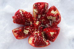 Ripe pomegranate fruit on snowy. Background.selective focus. closeup Royalty Free Stock Photos