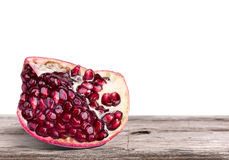 Ripe pomegranate fruit on a table Royalty Free Stock Image