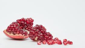 Ripe pomegranate fruit on white background cutout Stock Photo