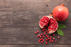 Ripe pomegranate fruit on wooden vintage background Stock Images