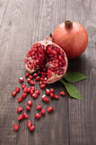 Ripe pomegranate fruit on wooden vintage background stock image