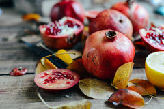 Ripe pomegranate fruit on wooden vintage background. Red juice p Royalty Free Stock Images