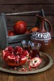 Ripe pomegranate fruit on wooden vintage background. Red juice pomegranate on dark background. Fresh juicy pomegranate - Stock Images