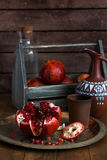 Ripe pomegranate fruit on wooden vintage background. Red juice pomegranate on dark background. Fresh juicy pomegranate - Stock Photos
