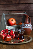 Ripe pomegranate fruit on wooden vintage background. Red juice pomegranate on dark background. Fresh juicy pomegranate - Stock Images