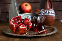 Ripe pomegranate fruit on wooden vintage table. Close view Royalty Free Stock Images