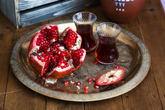 Ripe pomegranate fruit on wooden vintage table. Close view Stock Photos