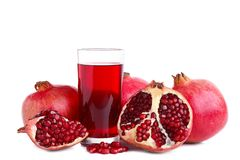 Ripe pomegranate fruits and glass of juice isolated on white background royalty free stock images