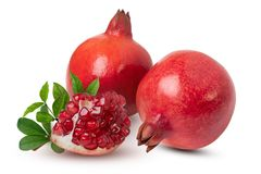 Ripe pomegranate fruits with leaves on the white background. With clipping path stock photo