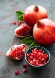 Ripe pomegranate fruits. On  black concrete background royalty free stock photography