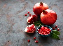 Ripe pomegranate fruits. On  black concrete background stock photography