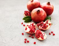 Ripe pomegranate fruits. On  grey concrete background royalty free stock images
