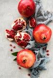 Ripe pomegranate fruits. On  grey concrete background stock photos
