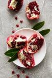 Ripe pomegranate fruits. On  grey concrete background stock photo