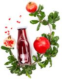 Ripe pomegranate fruits, seeds and juice. Royalty Free Stock Images