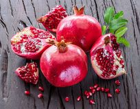 Ripe pomegranate fruits on the wooden background. stock photo