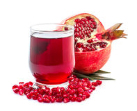 Ripe pomegranate and glass of juice Stock Photo