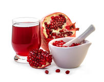 Ripe pomegranate and glass of juice Royalty Free Stock Photos