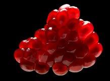 Ripe pomegranate isolated on black. Close-up of pomegranate segment on black background Royalty Free Stock Photography