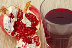 Ripe pomegranate and juice in a glass Royalty Free Stock Images