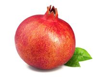 Ripe pomegranate with a leaf  on white background Stock Photos