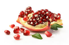Ripe pomegranate with leafs close-up Royalty Free Stock Photo