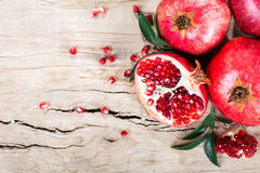 Ripe pomegranate with leaves Royalty Free Stock Photo