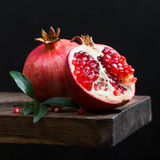 Ripe pomegranate with leaves Stock Images