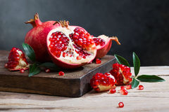 Ripe pomegranate with leaves Royalty Free Stock Images