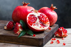 Ripe pomegranate with leaves Stock Photos