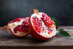 Ripe pomegranate with leaves Royalty Free Stock Photos