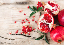 Ripe pomegranate with leaves Royalty Free Stock Photography