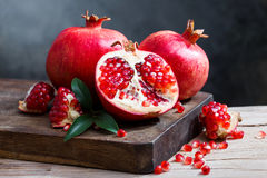 Ripe pomegranate with leaves Stock Photo