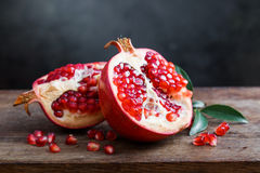 Ripe pomegranate with leaves Stock Photography
