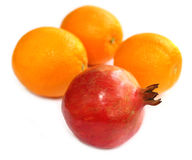 Ripe pomegranate with oranges Royalty Free Stock Photography