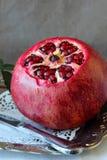 Ripe pomegranate  on a platter Royalty Free Stock Photo