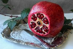 Ripe pomegranate  on a platter Royalty Free Stock Photo